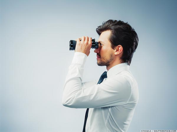 Business man in shirt and tie with binoculars