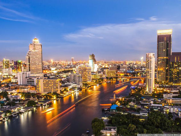 Hotels along the Chao Phraya River after sunset